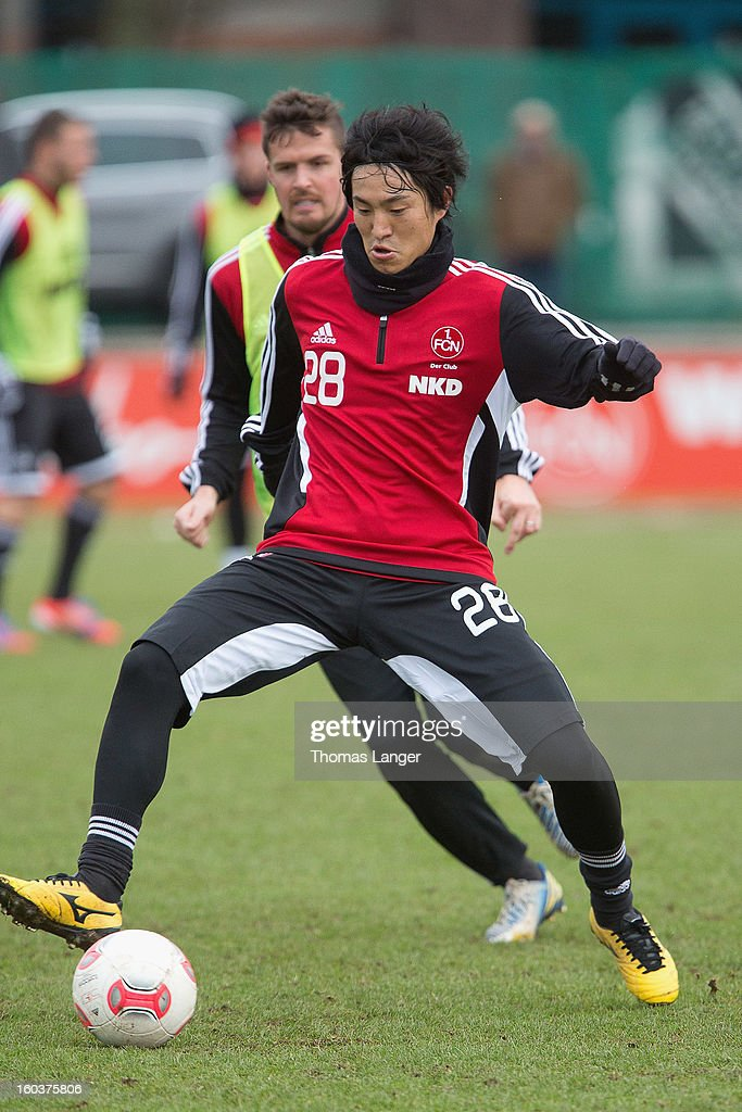 New player Mu Kanazaki of 1 FC Nuernberg and teammate Per Nilsson (L) compete for the ball during a training session on January 30, 2013 at the Sportpark Valznerweiher in Nuremberg, Germany.