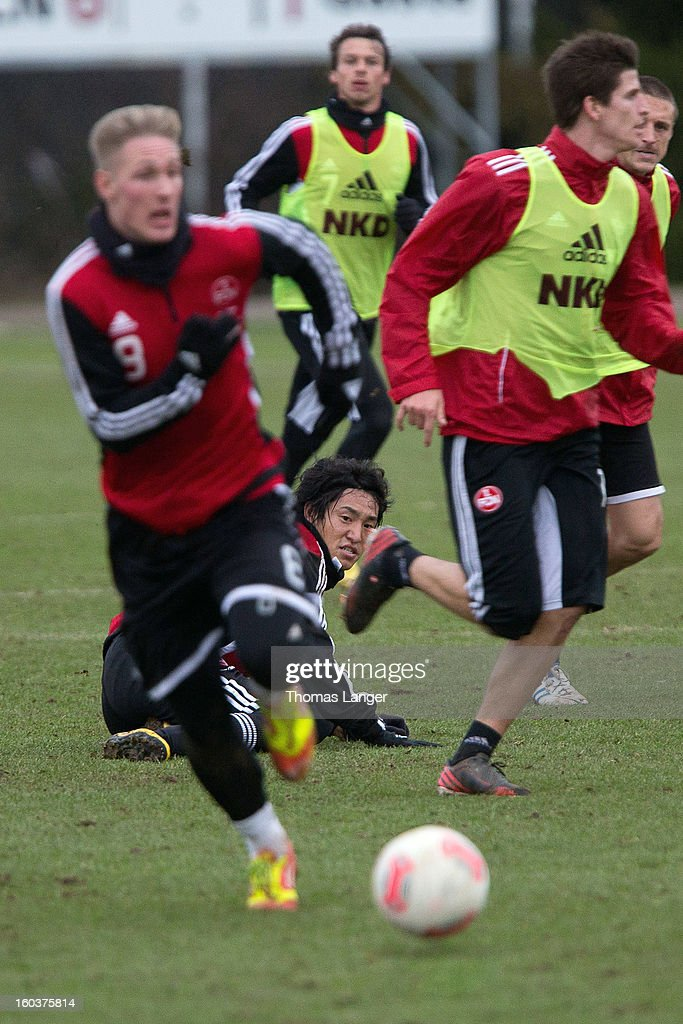 New player Mu Kanazaki of 1 FC Nuernberg lies on the floor during a training session on January 30, 2013 at the Sportpark Valznerweiher in Nuremberg, Germany.