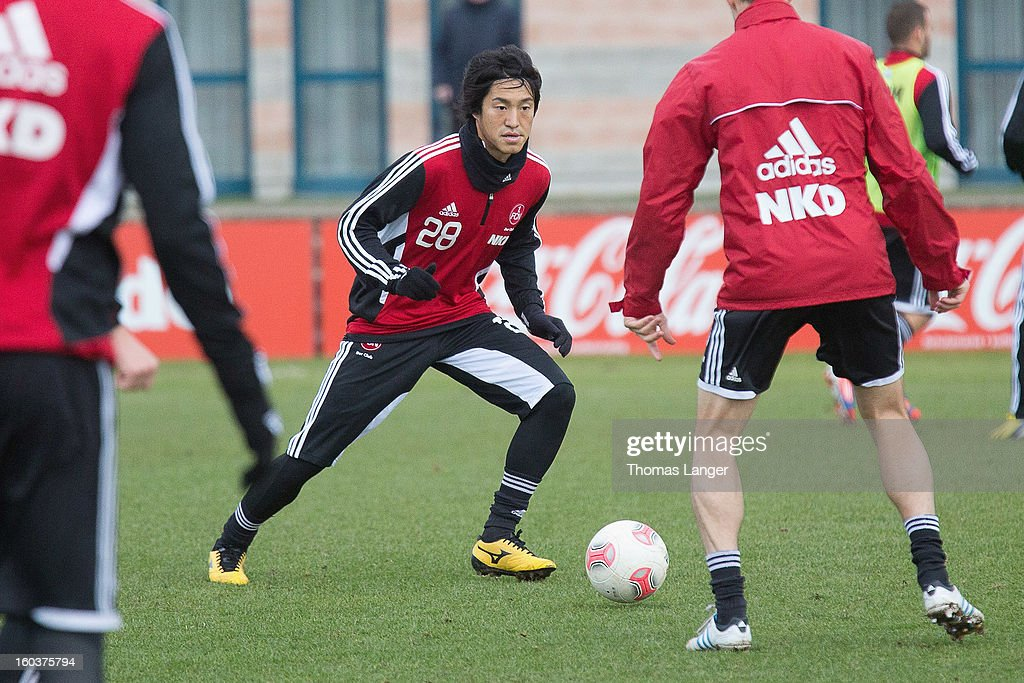 New player Mu Kanazaki of 1 FC Nuernberg runs with the ball during a training session on January 30, 2013 at the Sportpark Valznerweiher in Nuremberg, Germany.