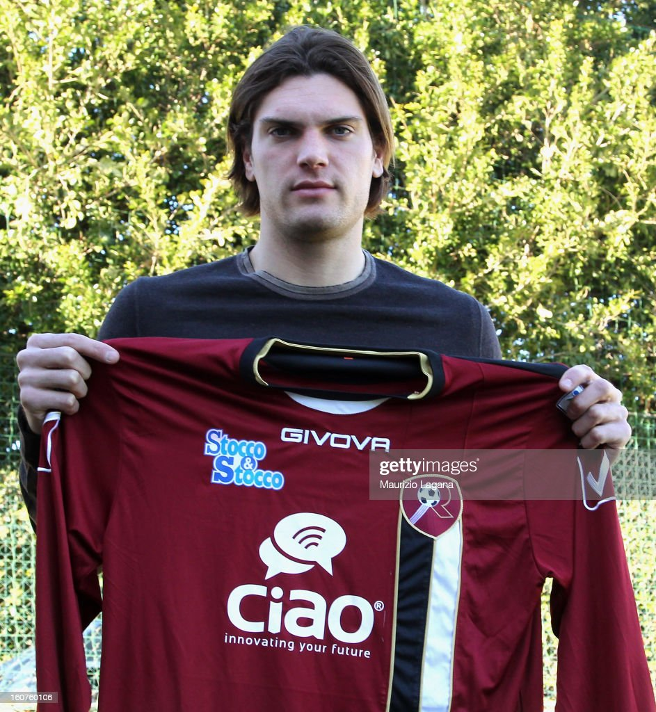 New player of Reggina, Federico Gerardi poses showing his new team shirt at Sports Center Sant'Agata on February 5, 2013 in Reggio Calabria, Italy.