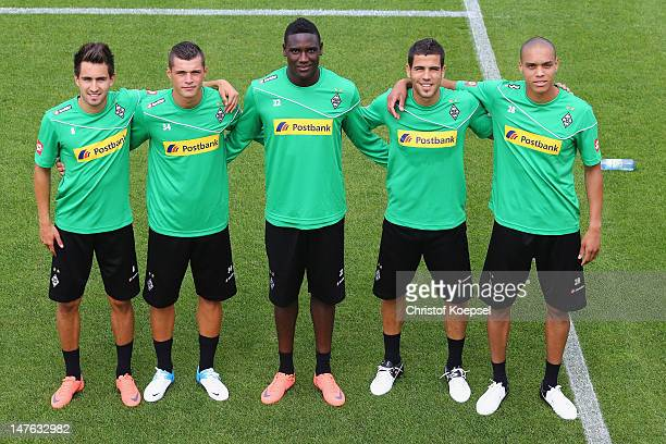 New players Lukas Rupp Xahka Peniel Mlapa Alvaro Dominguez and Anderson pose during the training session of Borussia Moenchengladbach the club's...