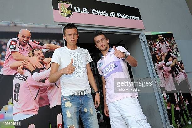 New players of US Citta di Palermo Armin Bacinovic and Josip Ilicic gesture before entering Palermo headquarters to undergo medicals at University...