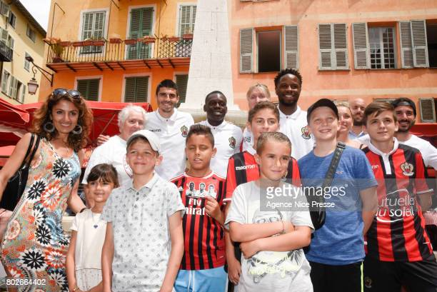 New players Pierre Lees Melou Jean Victor Makengo and Adrien Tameze of Nice with fans during fan's meeting with new players of OGC Nice on June 28...
