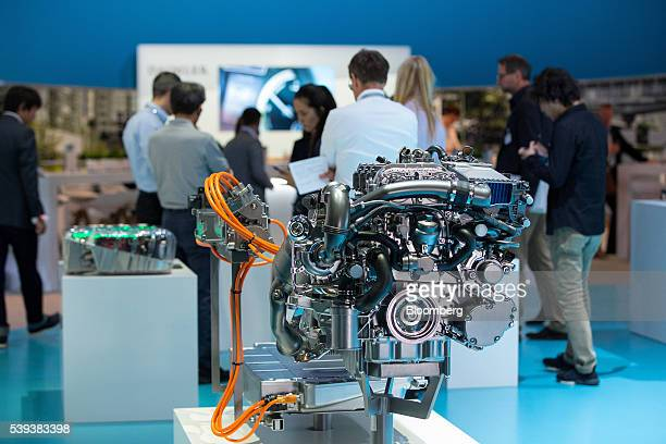 A new pluginhybrid automobile engine manufactured by Daimler AG sits on display during Daimler's TecDay Road to the Future event in Stuttgart Germany...