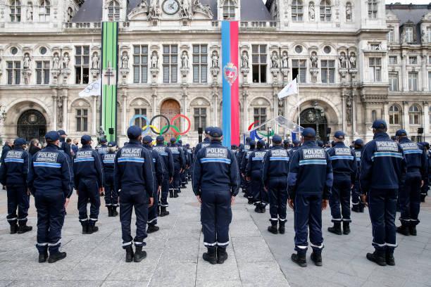 FRA: Paris Mayor Anne Hidalgo Presents The First 154 members Of The Paris Municipal Police At Parvis De L'Hotel De Ville