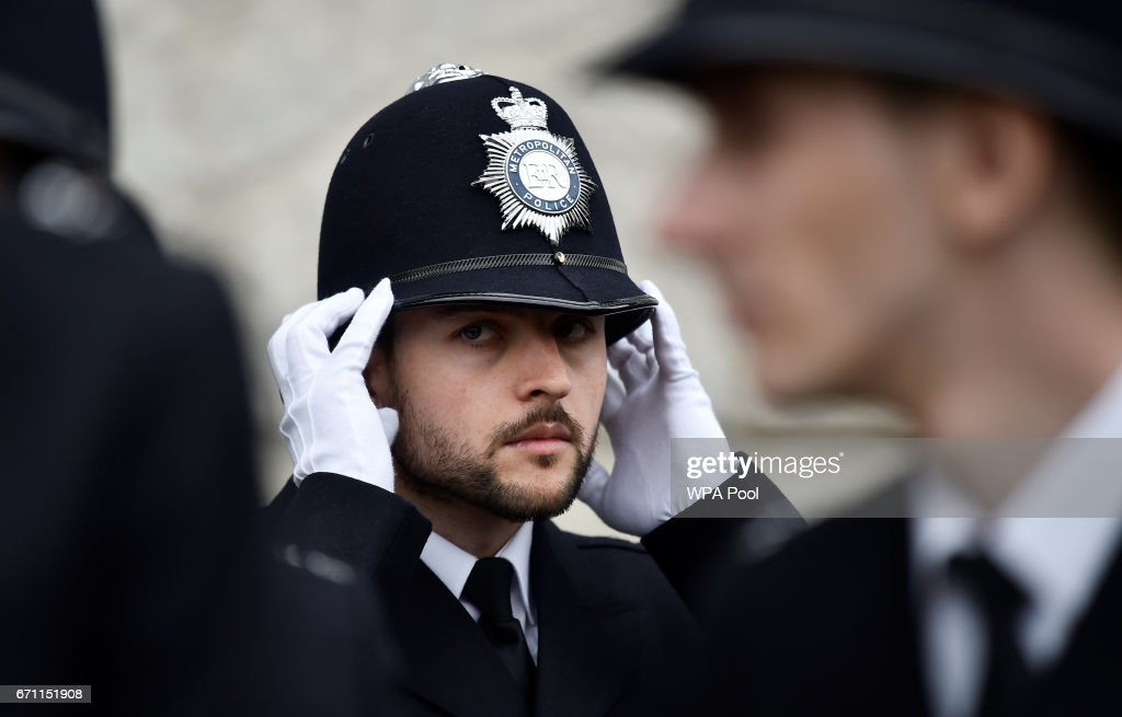 A new police recruit prepares to take part in a passing-out parade at the Metropolitan Police Academy at Peel House, Hendon on April 21, 2017 in London, England.