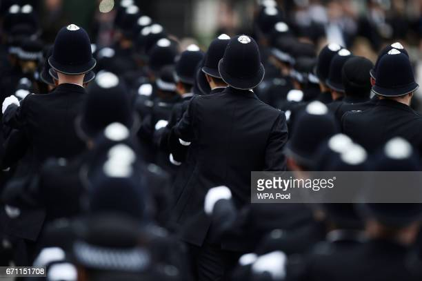 New Police recruits take part in a passingout parade at the Metropolitan Police Academy at Peel House Hendon on April 21 2017 in London England