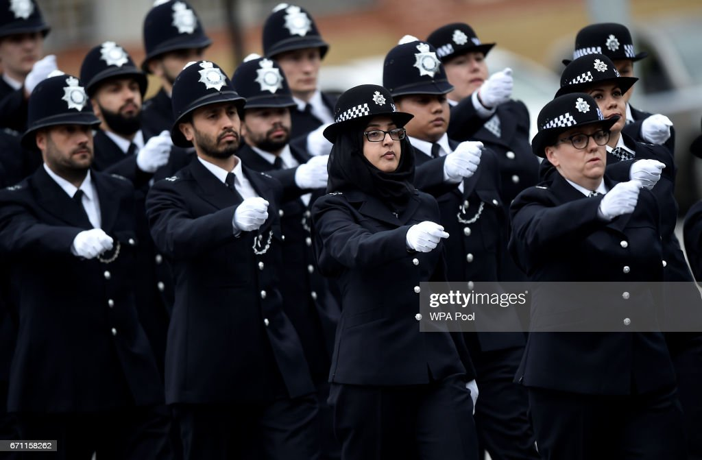 New Police recruits take part in a passing-out parade at the Metropolitan Police Academy at Peel House, Hendon on April 21, 2017 in London, England.