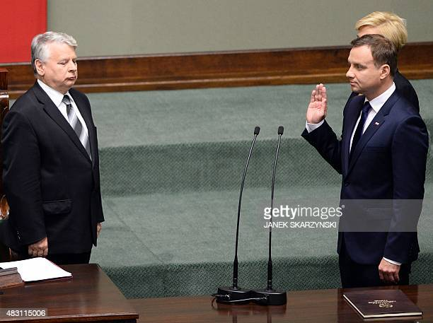 New Polish President Andrzej Duda is sworn in in front of the speaker of Senat Bogdan Borusewicz at the parliament on August 6 2015 in Warsaw AFP...