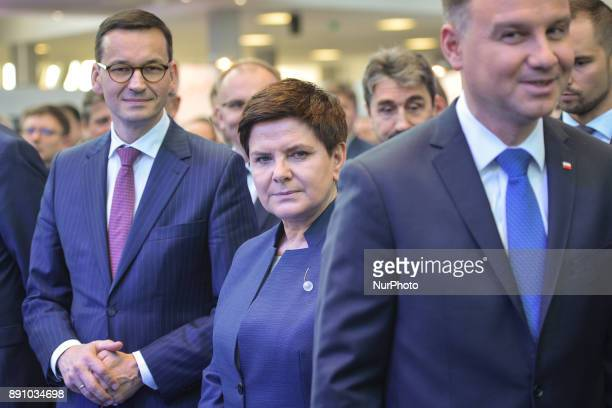 A new Polish Prime Minister Mateusz Morawiecki pictured with the Polish President Andrzej Duda and the former Polish Prime Minister and current...