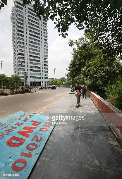 New polished granite flooring being laid out outside the Incometax office in New Delhi on July 11 2010