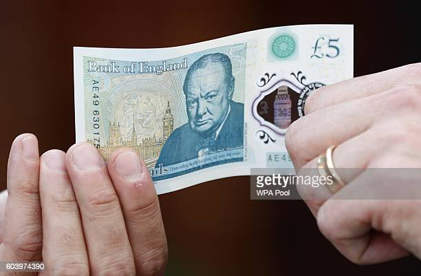 A new polymer five pound note at Whitecross Street Market on September 13 2016 in London United Kingdom The new plastic note is designed to be more...
