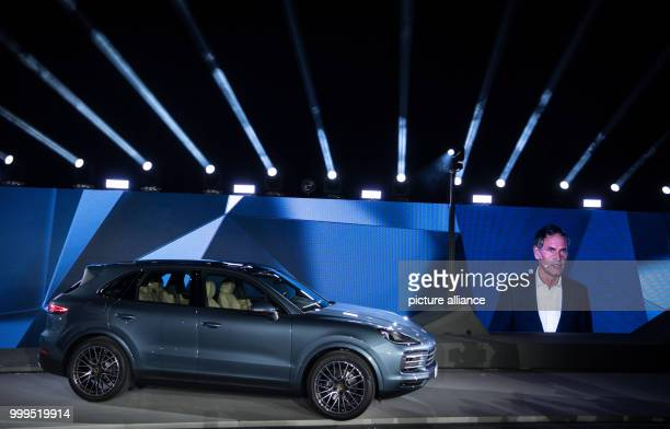 A new Porsche Cayenne is standing on the stage next to a picture of Porsche CEO Oliver Blume during the presentation of the new series in Stuttgart...
