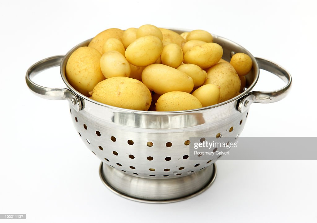 New potatoes in colander scrubbed ready to cook. : Stock Photo