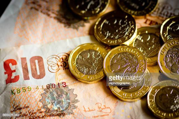 new pound coin released 2017 and notes - ten pound note stock photos and pictures