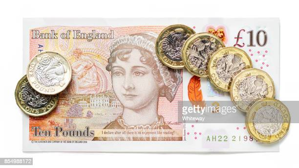 new pound coins and new uk ten pound note - ten pound note stock photos and pictures