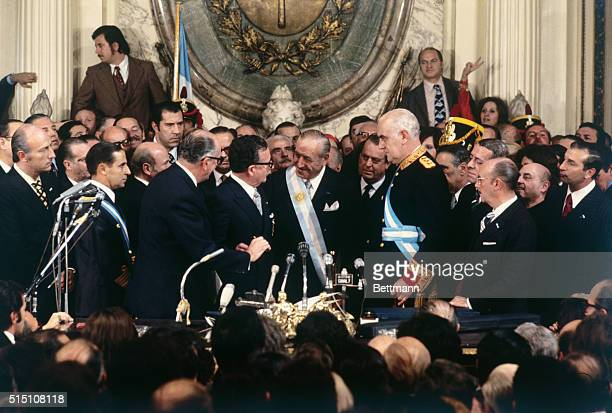 New President Hector Campora is congratulated by Chile President Salvatore Allende and outgoing President Gen Alejandro Lanusse Campora a Peronist...