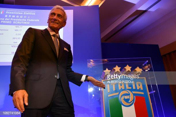 New President of the Italian Football Federation Gabriele Gravina shows the federation's logo as he reacts following the vote during the elective...