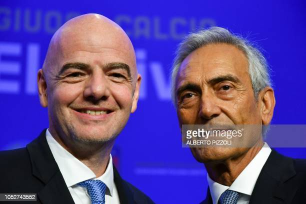 New President of the Italian Football Federation Gabriele Gravina poses with FIFA President Gianni Infantino following the vote during the elective...