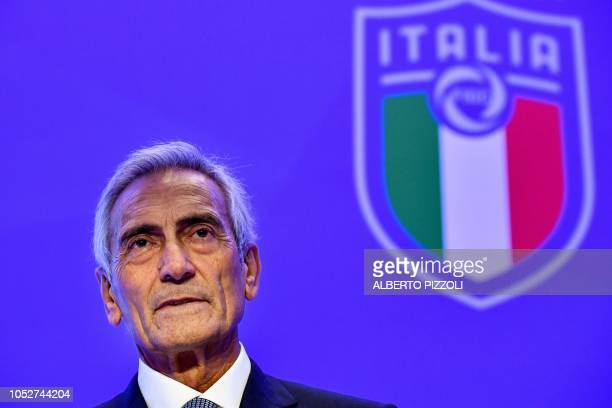 New President of the Italian Football Federation Gabriele Gravina poses with the federation's logo following the vote during the elective assembly of...
