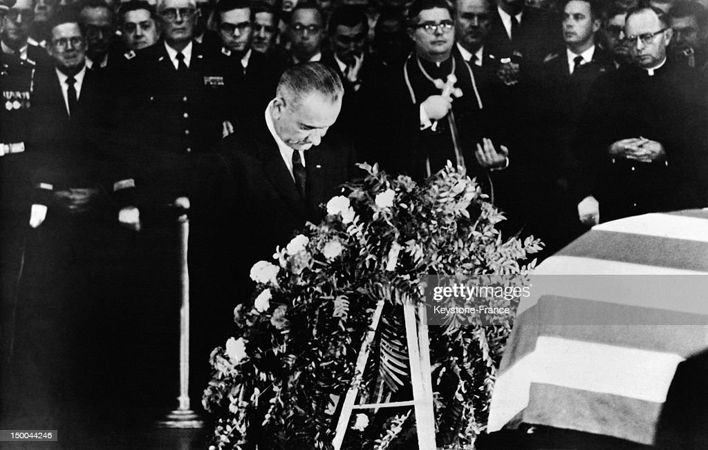 New President of the United States Lyndon Johnson praying on the coffin of President Kennedy at the Capitol behind the wreath of presidency on November 24, 1963 in Washington DC, United States.