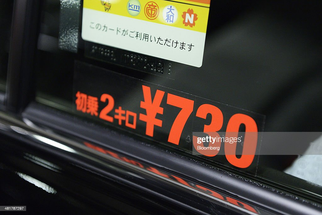 Price Signs On Nihon Kotsu Co. Taxies Are Changed In Garage As Japan Increases Sales Tax : News Photo