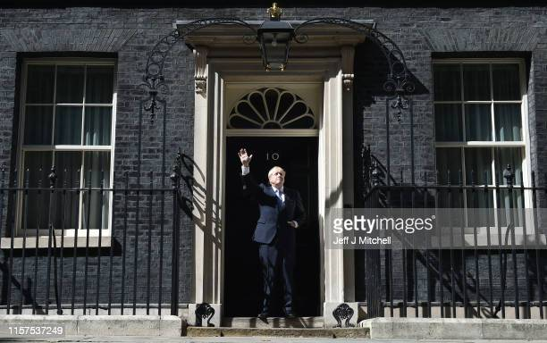 New Prime Minister Boris Johnson waves from the door of Number 10 Downing Street after speaking to the media on July 24 2019 in London England Boris...