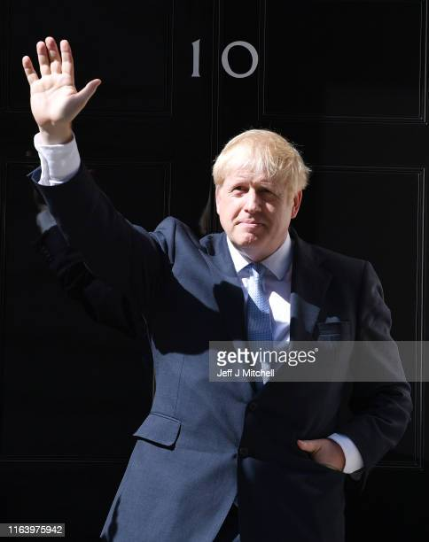New Prime Minister Boris Johnson waves from the door of Number 10, Downing Street after speaking to the media on July 24, 2019 in London, England....