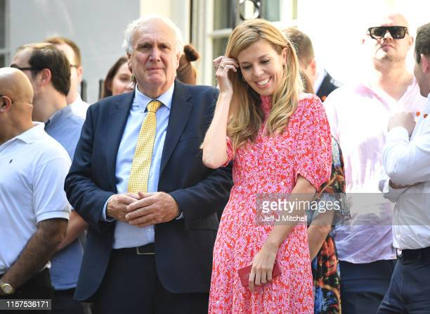 New Prime Minister Boris Johnson's girlfriend Carrie Symonds waits for Boris to arrive at Number 10 Downing Street on July 24 2019 in London England...