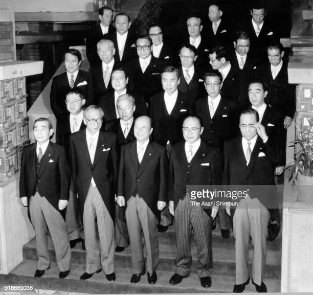New Prime Minister Kiichi Miyazawa and his cabinet members pose for photographs at the prime minister's official residence on November 5 1991 in...
