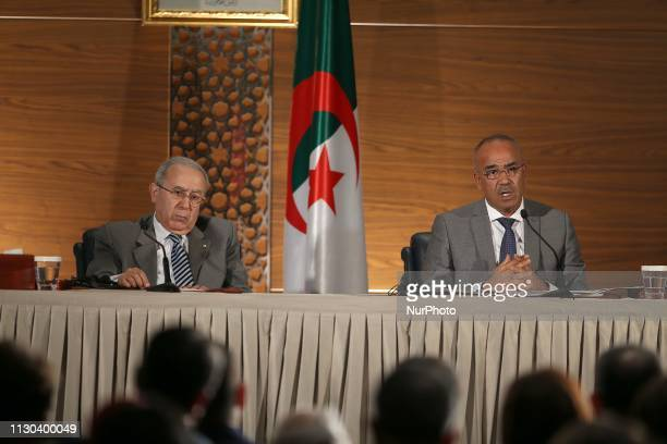New Prime Minister Noureddine Bedoui hosts a press conference with Deputy Prime Minister Ramadan Lamamra in Algiers on March 14 2019 Algeria's...