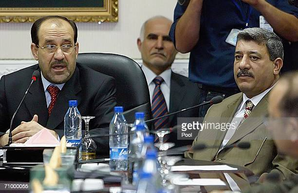New Prime Minister Nuri alMaliki and Salam alZaubai acting Defence Minister attend a cabinet meeting May 21 2006 in Baghdad Iraq Maliki announced...