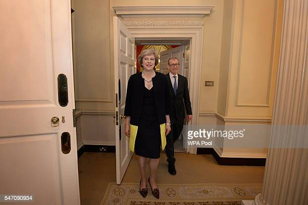 New Prime Minister Theresa May followed by her husband Philip John arrives at 10 Downing Street after meeting Queen Elizabeth II and accepting her...