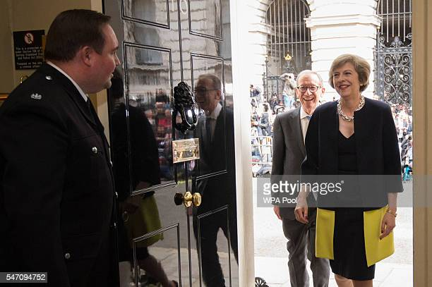 New Prime Minister Theresa May followed by her husband Philip John walks into 10 Downing Street after meeting Queen Elizabeth II and accepting her...