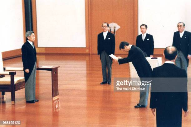 New Prime Minister Toshiki Kaifu receives the appointment letter from Emperor Akihito during the attestation ceremony at the Imperial Palace on...