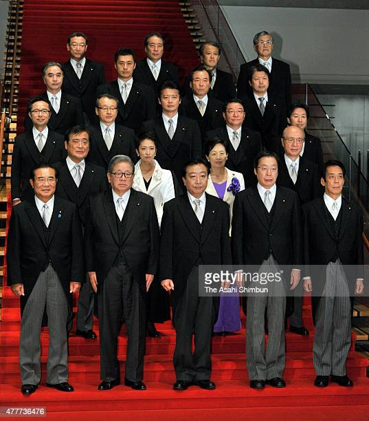 New Prime Minister Yoshihiko Noda and his cabinet members pose for photographs at Noda's official residence on September 2 2011 in Tokyo Japan
