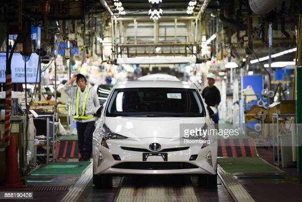 New Prius hybrid automobile stands on the final quality check production line at the Toyota Motor Corp. Tsutsumi plant in Toyota City, Aichi, Japan,...