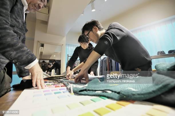 new product development meeting at apparel company's design office, in shibuya-ku, tokyo, japan - design professional ストックフォトと画像