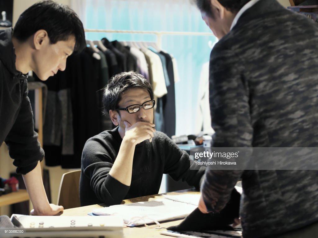 New product development meeting at apparel maker's design office, in Shibuya-ku, Tokyo, Japan : Stock-Foto