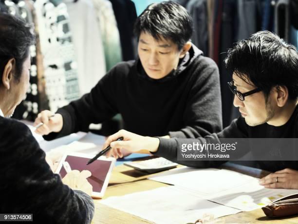 New product development meeting at apparel maker's design office, in Shibuya-ku, Tokyo, Japan