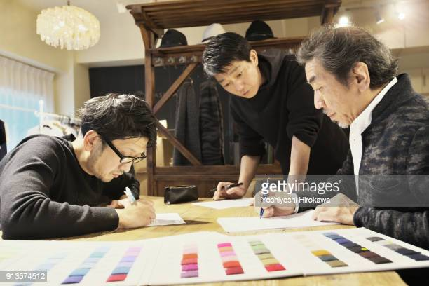 new product development meeting at apparel maker's design office, in shibuya-ku, tokyo, japan - vanguardians stock pictures, royalty-free photos & images