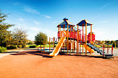 New Public Suburban Children park playground in California with slides on a sunny day