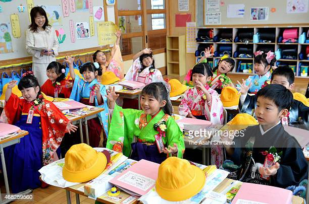 New pupils wearing traditional hakama attend their first class after the welcome ceremony at Ryori Elementary School on April 1 2015 in Ofunato Iwate...