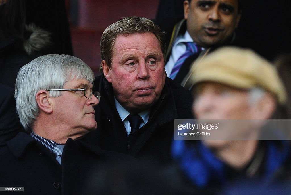 New Queens Park Rangers Manager Harry Redknapp watches from the stands during the Barclays Premier League match between Manchester United and Queens Park Rangers at Old Trafford on November 24, 2012 in Manchester, England.
