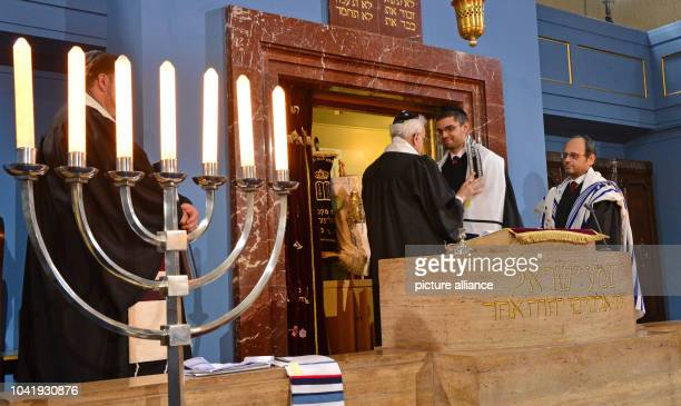 New rabbi Alexander Nachama is blessed by rabbi Walter Jacob while rabbi Reuben BarEphraim looks on during an ordination ceremony at the New...