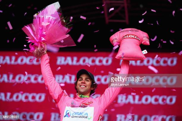 New race leader and wearer of the maglia rosa Michael Matthews of Australia and OricaGreenEdge celebrates on the podium after the second stage of the...