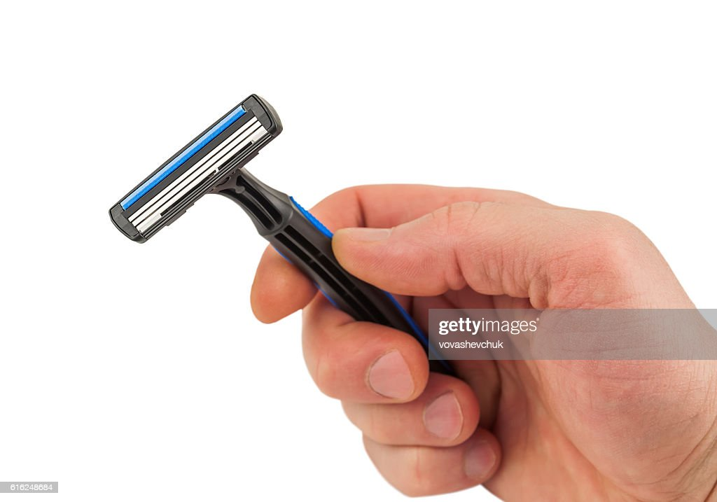 new razor in hand : Foto de stock