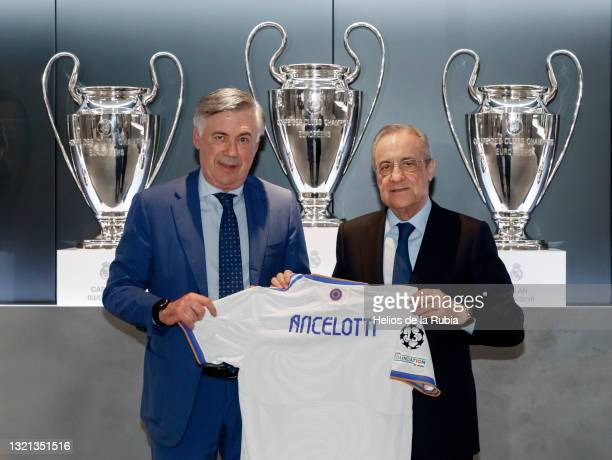 New Real Madrid Head Coach Carlo Ancelotti poses with the club's President Florentino Pérez during his official presentation on June 02, 2021 in...