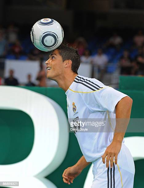New Real Madrid player Cristiano Ronaldo controls a ball during his presentation at the Santiago Bernabeu stadium on July 6 2009 in Madrid Spain