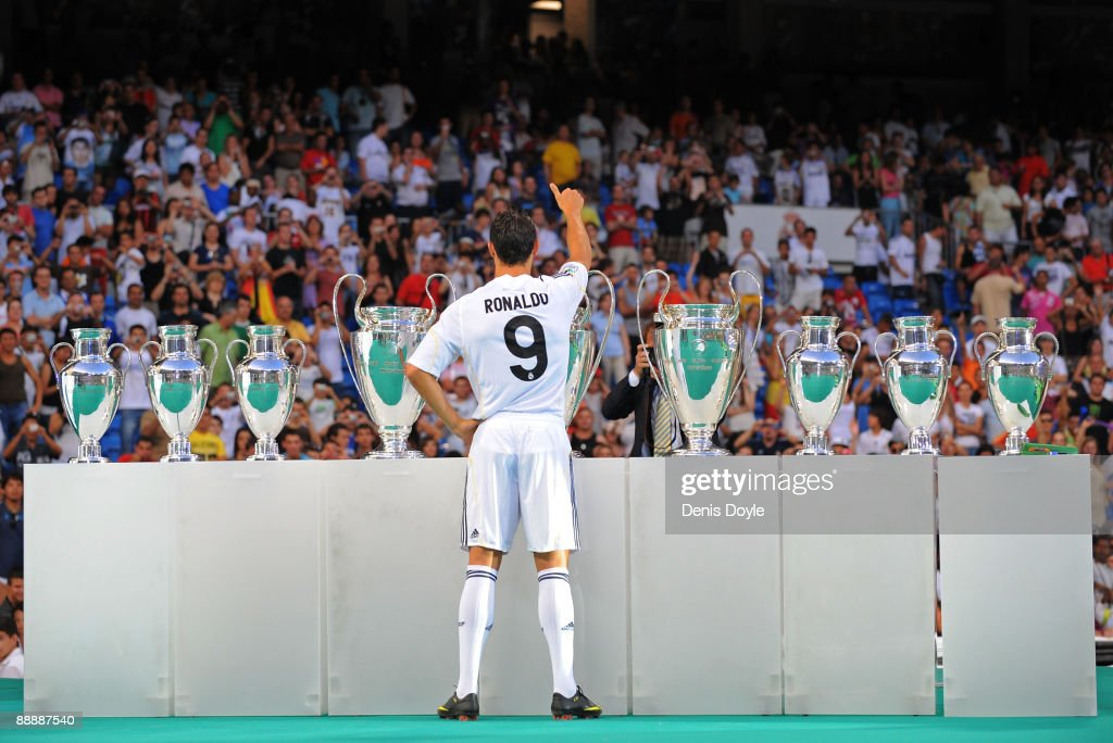 New Real Madrid player Cristiano Ronaldo waves to fans during his presentation at the Santiago Bernabeu stadium on July 6, 2009 in Madrid, Spain.